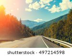 mountain road at sunset with... | Shutterstock . vector #497214598