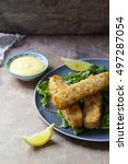 Small photo of Crispy fish fingers with aioli and rocket salad