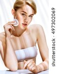 woman cares for face skin using ... | Shutterstock . vector #497302069