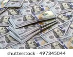 Small photo of Background of a large number of new banknotes hundred dollars. Type acute angle