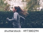 woman running. female runner... | Shutterstock . vector #497380294
