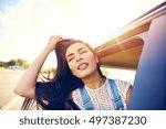 gorgeous young woman enjoying a ... | Shutterstock . vector #497387230