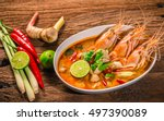 Stock photo tom yum goong thai hot spicy soup shrimp with lemon grass lemon galangal and chilli on wooden 497390089