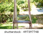 Wooden Swing With Ribbons In...