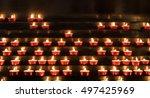 Many Burning Devotional Candle...