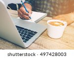 man write on notebook with... | Shutterstock . vector #497428003