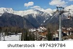 Ski resort in the Caucasian mountains, cable way and cottage village - stock photo