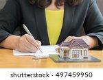 businesswoman signing a... | Shutterstock . vector #497459950