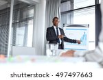 young businessman pointing... | Shutterstock . vector #497497663