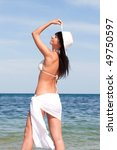 young fashion woman on the beach | Shutterstock . vector #49750597