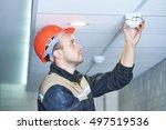 worker installing smoke... | Shutterstock . vector #497519536