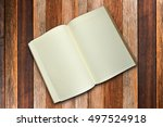book on wood background | Shutterstock . vector #497524918
