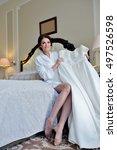 beautiful bride in robe is... | Shutterstock . vector #497526598