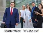 well dressed business team... | Shutterstock . vector #497555659