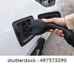charging an electrical vehicle... | Shutterstock . vector #497573290