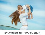 happy family. young mother... | Shutterstock . vector #497601874