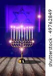 Nine candles in a silver jewish hanukkah candle holder - stock photo
