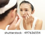 young woman having skin problems | Shutterstock . vector #497636554