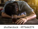 drunk man with a glass of... | Shutterstock . vector #497666374