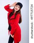 the girl flaunts in a coat | Shutterstock . vector #497715724