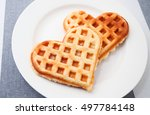 heart shaped waffles over... | Shutterstock . vector #497784148