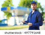 young mechanic in uniform with... | Shutterstock . vector #497791648