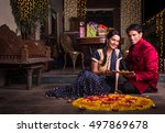 young and smart indian couple... | Shutterstock . vector #497869678