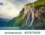 Mountain landscape with cloudy sky. Beautiful nature Norway. Geiranger fjord. Seven Sisters Waterfall - stock photo