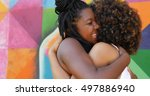 women meeting and hugging in... | Shutterstock . vector #497886940