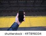 phone in hand in the subway | Shutterstock . vector #497898334