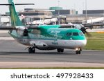 Small photo of Manchester, United Kingdom - May 08, 2016: Aer Lingus ATR 72-600 twin-engine turboprop short-haul regional passenger plane (EI-FAT) taxiing on Manchester International Airport tarmac.