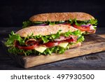 two fresh submarine sandwiches... | Shutterstock . vector #497930500