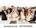 groomsmen in black tuxedos wave ... | Shutterstock . vector #497944000