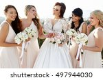 wind blows hair of pretty bride ... | Shutterstock . vector #497944030