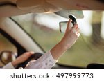 the girl in the car adjusts the ... | Shutterstock . vector #497999773