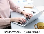 closeup of business woman hand... | Shutterstock . vector #498001030