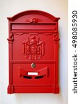 A Bright Red Post Box On White...