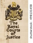 Small photo of London, United KIngdom - October 13, 2016: Royal Courts of Justice. The signage of the Royal Courts of Justice are as full of the pomp and circumstance you would expect from such hallowed courts.