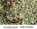 pumpkin seeds in wooden spoon   | Shutterstock . vector #498170584