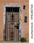 Small photo of Architectural detail of Santa Fe, New Mexico - wooden door in adobe building.
