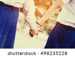 young couple in love holding... | Shutterstock . vector #498235228