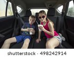 kids eating a treat in the back ... | Shutterstock . vector #498242914