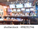 Stock photo blurred image of sport and oyster bar with tv classic counter tables and chairs in houston texas 498251746
