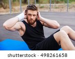 young bearded sports man doing...   Shutterstock . vector #498261658