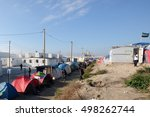 "Small photo of Calais, France - October 13 2016: refugee camp ""Jungle"" in Calais, with tents and makeshift shelters."
