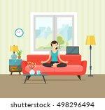 woman meditating. living room.... | Shutterstock .eps vector #498296494