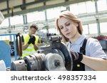 mature female worker working on ... | Shutterstock . vector #498357334