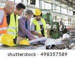 male supervisor with workers... | Shutterstock . vector #498357589