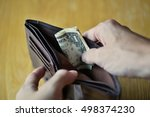 male hands opening an almost... | Shutterstock . vector #498374230