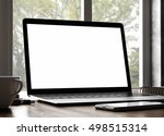3d rendering of laptop on table | Shutterstock . vector #498515314